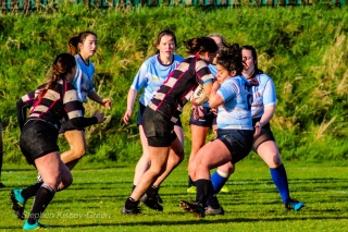 Casey O'Brien is bumped off by a strong carry from an Old Belvedere RFC attacker. Photo: Stephen Kisbey-Green