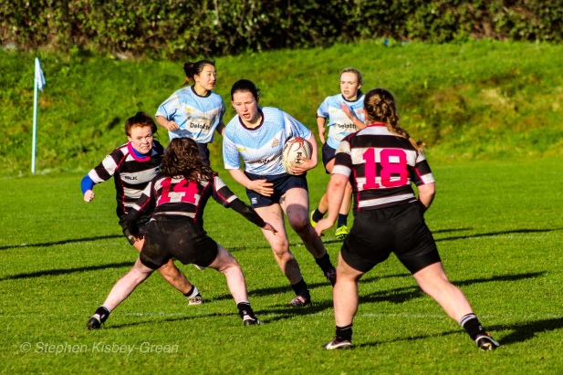 DCU run into a strong tackle from Old Belvedere RFC. Photo: Stephen Kisbey-Green
