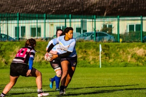 Eimear Corri spreads the ball wide after drawing in an Old Belvedere RFC defender. Photo: Stephen Kisbey-Green