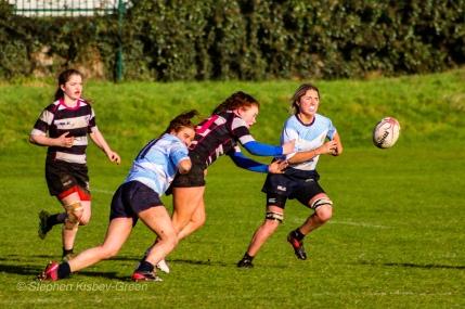 Louise McCleery putting in the effort on defense against Old Belvedere RFC. Photo: Stephen Kisbey-Green