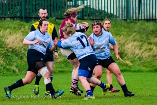 Niamh Tester of DCU puts a massive hit on a Tullow attacker. Photo: Stephen Kisbey-Green