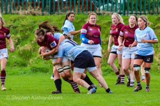 Maeve Donohue helps Casey O'Brien make a big tackle against Tullow RFC. Photo: Stephen Kisbey-Green
