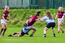 Zoe Valentine drags down the Tullow RFC attack. Photo: Stephen Kisbey-Green