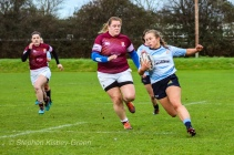 Leah Reilly making a break against Tullow RFC, before offloading the ball to her captain Hannah Heskin, who would go on to score a try. Photo: Stephen Kisbey-Green