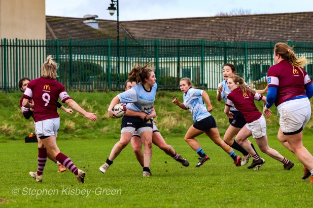 Maeve Donohue looks to offload the ball after a powerful break against Tullow RFC. Photo: Stephen Kisbey-Green