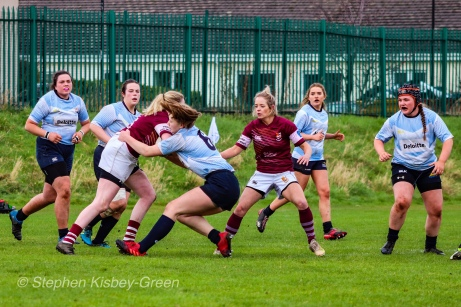 Nikki Gibson looks to bring down a strong run from Tullow RFC. Photo: Stephen Kisbey-Green