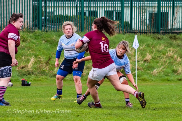 Zoe Valentine lines up the Tullow RFC flyhalf, ready to make the tackle. Photo: Stephen Kisbey-Green