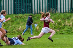 Maeve Donohue makes a desperate dive to stop a brilliant run from Tullow RFC, connecting with an ankle tap. Photo: Stephen Kisbey-Green