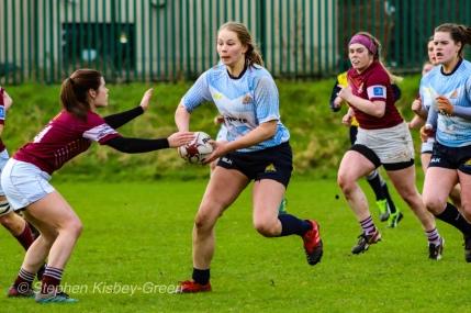 Nikki Gibson crashing the ball up for DCU. Photo: Stephen Kisbey-Green