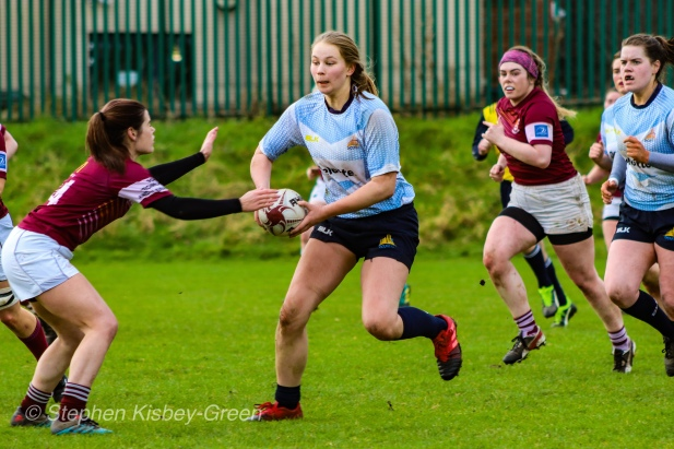 Nikki Gibson crashing the ball up for DCU. Photo: Stephen Kisbey-Green
