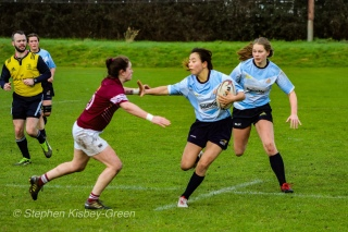 Kirara Kasahara looks to hand off Tullow RFC's wing on her way to the try line, being stopped just short by some great cover defense. Photo: Stephen Kisbey-Green