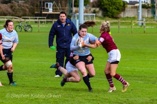 Hannah Heskin looks to break a Tullow RFC tackle on the wing, while coach Eddie Fallon shouts orders from the sideline. Photo: Stephen Kisbey-Green