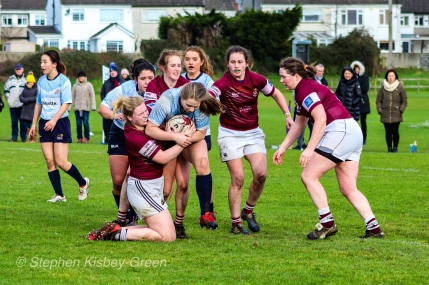 Nikki Gibson is stopped by two Tullow RFC defenders. Photo: Stephen Kisbey-Green