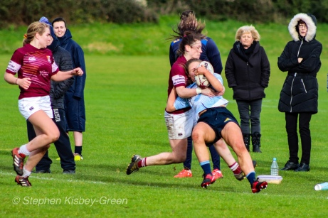Leah Reilly is tackled high over the touch line by a Tullow RFC defender. Photo: Stephen Kisbey-Green