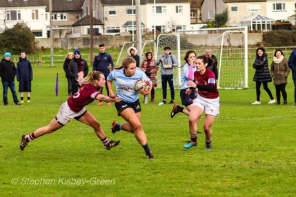 Leah Reilly scything through the Tullow RFC defense on her way to scoring one of DCU's six tries. Photo: Stephen Kisbey-Green