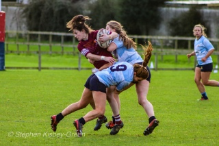 Louise McCleery and Nikki Gibson team up to take down a Tullow RFC runner. Photo: Stephen Kisbey-Green