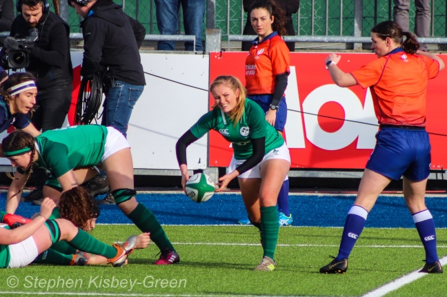 Kathryn Dane clears the ball out from a ruck against Scotland. Photo: Stephen Kisbey-Green