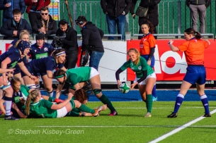 Kathryn Dane clears the ball out of the back of an Irish ruck against Scotland. Photo: Stephen Kisbey-Green