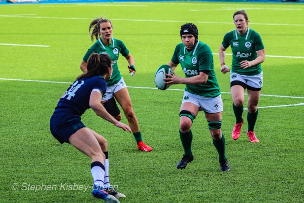Ciara Griffin lines up Rhona Lloyd with a powerful carry. Photo: Stephen Kisbey-Green