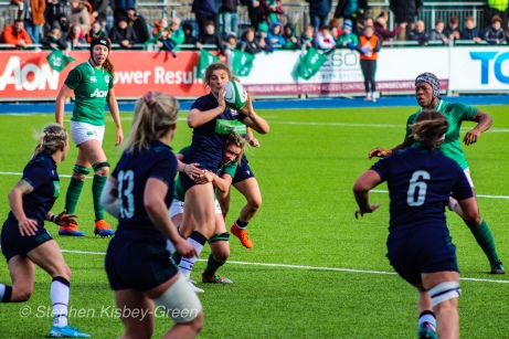 Scotland looks to offload the ball in the tackle against Ireland. Photo: Stephen Kisbey-Green