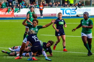 Sene Naoupu pulls out of a tackle on Chloe Rollie, after Rollie started ducking. Photo: Stephen Kisbey-Green