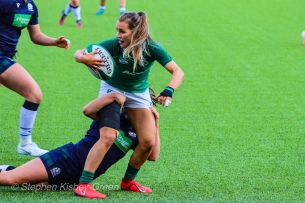 Aoife Doyle looks for support while being tackled by Scotland. Photo: Stephen Kisbey-Green