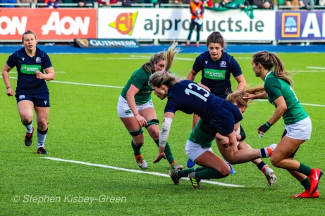 Hannah Smith is stopped on a powerful run by some solid Irish defense. Photo: Stephen Kisbey-Green
