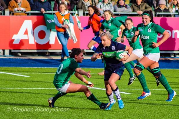 Scotland making a long and powerful run against Ireland. Photo: Stephen Kisbey-Green