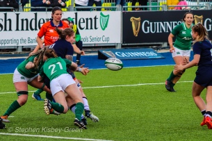 Jade Konkel offloads the ball in the tackle, just meters away from the try line against Ireland. Photo: Stephen Kisbey-Green