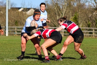 Claire Kealy crashes the ball up for DCU into some solid defense by Wicklow RFC. Photo: Stephen Kisbey-Green