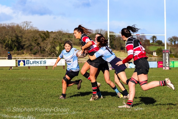 A good run from Wicklow RFC is shut down by DCU's cover defense. Photo: Stephen Kisbey-Green