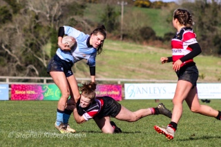 Kate Farrell McCabe brushes off a Wicklow tackler in an effective run. Photo: Stephen Kisbey-Green