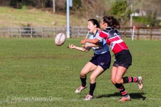 Kirara Kasahara offloads they ball in a tackle, despite being hit high. Photo: Stephen Kisbey-Green
