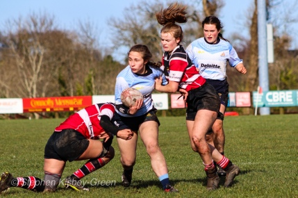 Leah Reilly looks to get her arms free to pass the ball out of a two-on-one tackle. Photo: Stephen Kisbey-Green