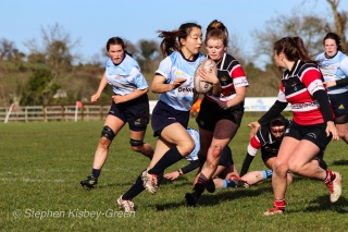 Kirara Kasahara steps inside, looking to beat a Wicklow defender on her shoulder. Photo: Stephen Kisbey-Green