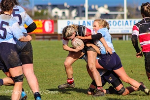 Jane Waters helps mouth a DCU teammate to stop a powerful Wicklow run. Photo: Stephen Kisbey-Green