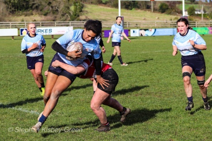 Eimear Corri brushes off a poor tackle from Wicklow, as she looks to add to her try tally. Photo: Stephen Kisbey-Green