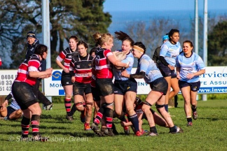 Nikki Gibson is hit high as she attempts to make meters against Wicklow RFC. Photo: Stephen Kisbey-Green